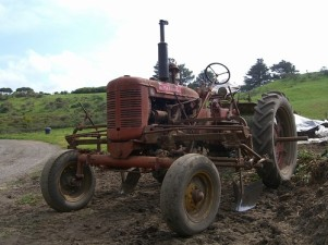 old farm tractor n plow
