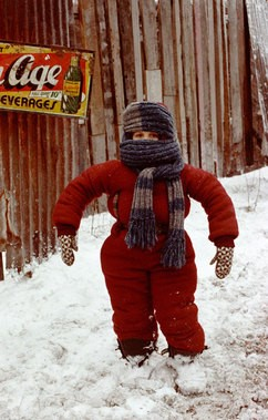 kid in full snowsuit