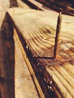 rusty nail in board